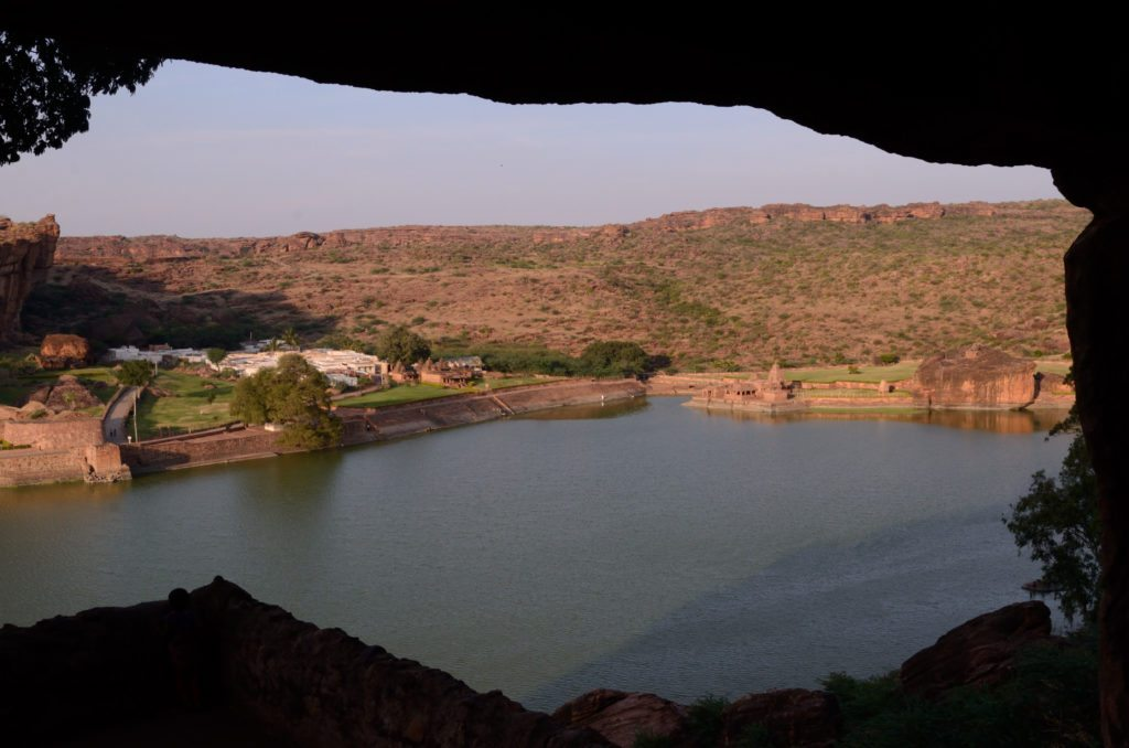 The Agastya Lake framed by the cave