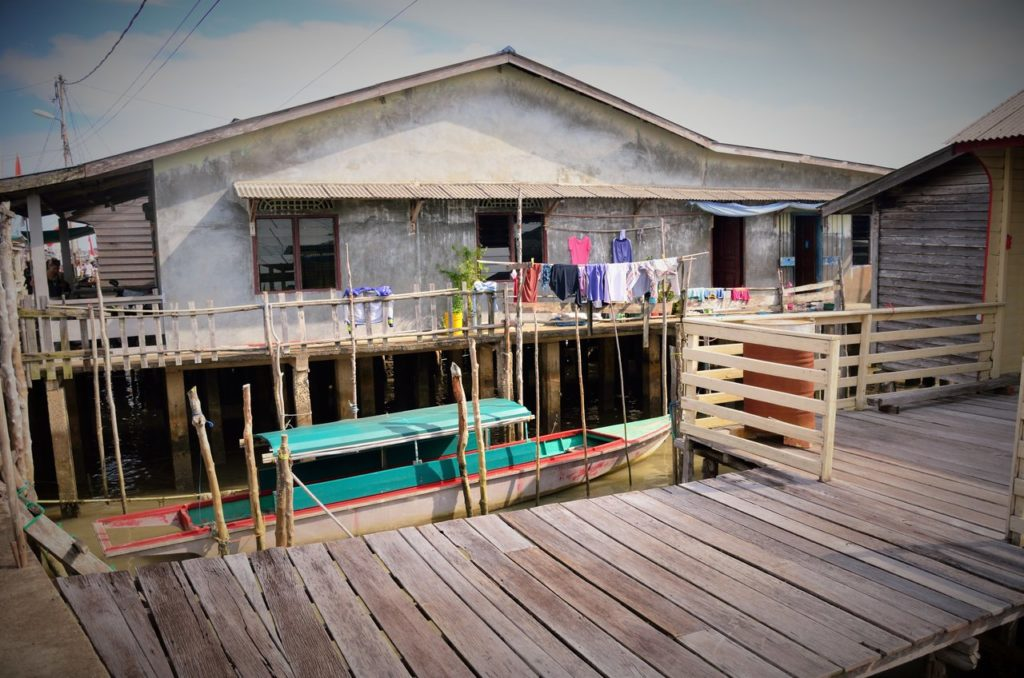 Old houses on stilts in Senggarang Bintan island