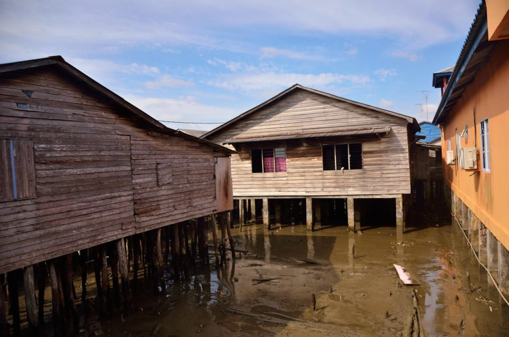 Old houses on stilts in Senggarang Bintan