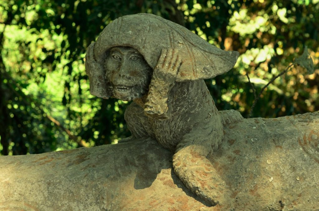 Monkey statue with leaf in Ubud Monkey Forest