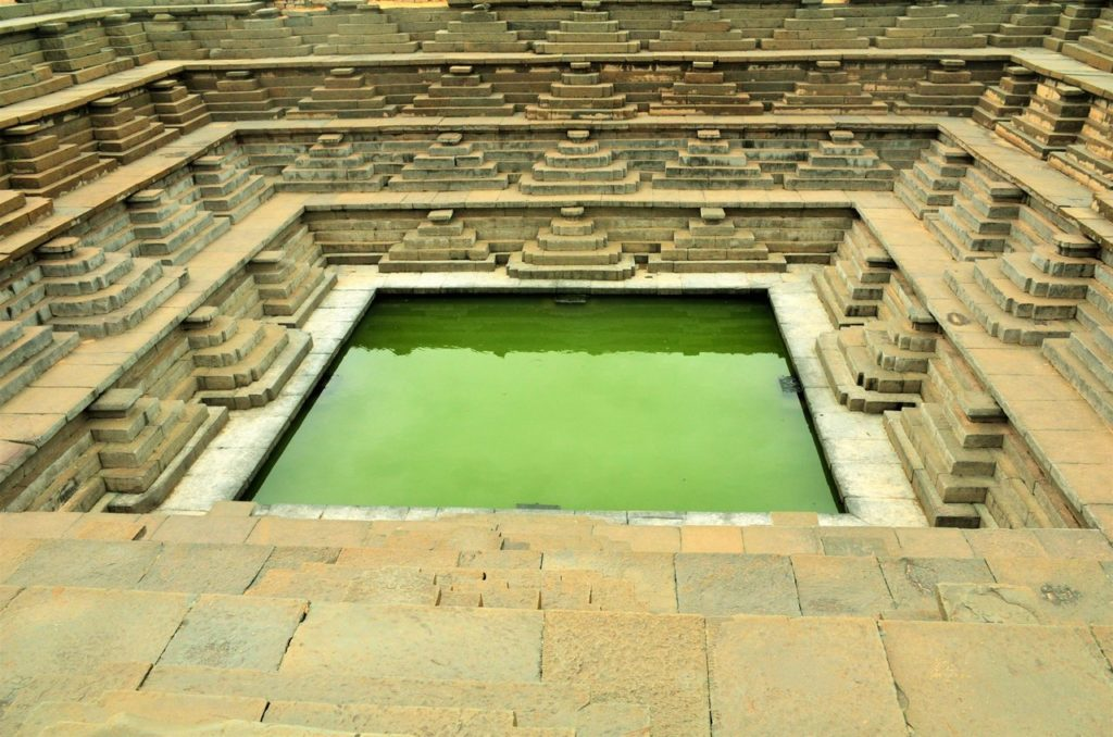Stepwells and octagonal wells in hampi, karnataka